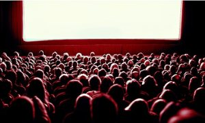 Crowd watching movie in theatre